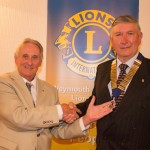 Norman Stagles (L) hands over the chain of office to the new Weymouth & Portland Lions President for 2015/16 Les Board