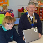 Lions President Les Board hands over another refurbished laptop