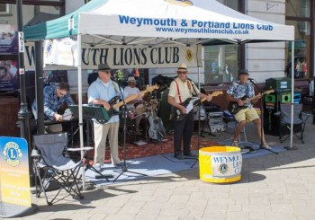 Lions Annual Street Busk on National Street Busk Day raises £831